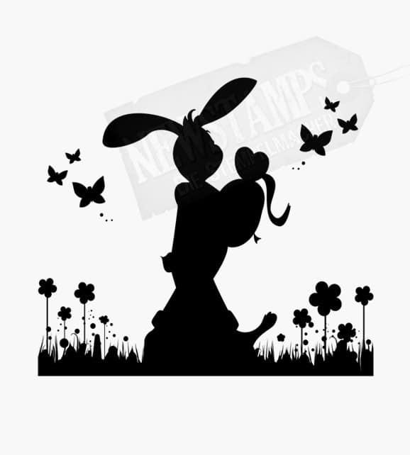 Motivstempel Ostern Hase hält ein Ei in der Hand und läuft über Wiese
