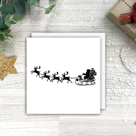 W015_Weihnachtsmann_mit_Rentieren_WV_Geschenk_Zweige